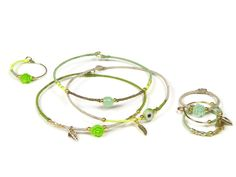 Beautiful delicate gold plated jewelry with silk and small charms. Bangle bracelets, rings, necklaces, earrings, hair accessories and more....More designs see www.sophisticatedgold.nl