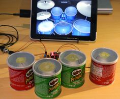 Ever wanted to unleash your inner rock god, but couldn't find the space to put a drum kit? Frustrated at trying to play GarageBand with fat fingers? Or just someone who can't stop eating crisps? Whichever it is, this is the project for you!This Instructable will show how to make a set of mini drum pads using Pringles tins, an Arduino, and some piezo sensors, which will trigger any MIDI device or computer drum synth. The pads are velocity-sensitive and as easy to play as drumming your…