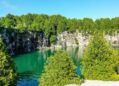 9) Elora Gorge Trail Grab your day bag and hike among the scenic limestone cliffs of the Elora Gorge. Follow the trail marked with cedar trees as you make your way to the real showstopper of the trail: A 20-foot waterfall. Note: This trail is only open between April and October.