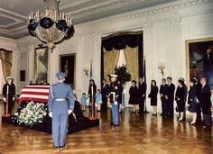 11/24/63: The Kennedy family waits in the White House East Room for the start of the procession as JFK's casket is carried on a military caisson to the Capitol to lie in state in the Rotunda.