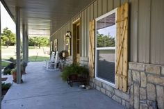 The rocks and shudders give it a nice home feel.   3451-07 Morton home~metal with stone