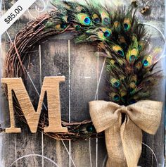 Wreath •~• initial & peacock feather