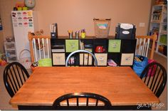 Since I like the darker wood and/or black, maybe I should repaint our kitchen table so it looks like this one.