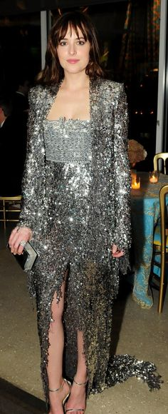Dakota Johnson's Golden Globes after party look was chock-full of shine.
