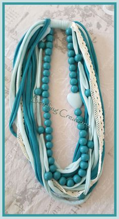 Handmade by me: Available at: HANDMADE_OOAK_WOODEN_BEAD_SPAGHETTI_YARN_T_SHIRT_FABRIC_NECKLACE_MALACHITE_GREEN_LIGHT_TURQUOISE.AVAILABLE FOR SALE AT: http://www.bidorbuy.co.za/seller/366992/Beadingcreations