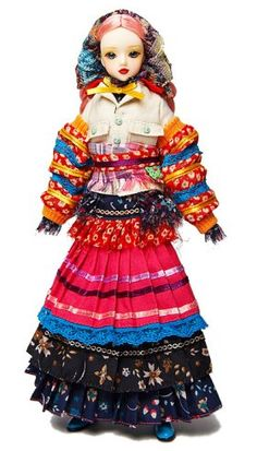 J-Doll Picasso St. West $74.95: She wears a colorful peasant-inspired outfit that is trimmed with ribbon and lace, and blue and green shoes. Included inside the box is a doll stand for display.