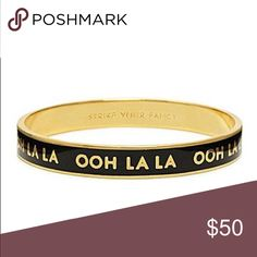 """Kate Spade ohh la la bangle """"Ohh la la"""" in black background and gold. In like new condition comes with dust bag and tag. Was only used a few times but selling because the bangle was big on my wrist. Comes from a smoke & pet free home. kate spade Jewelry Bracelets"""
