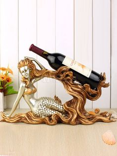 An array of single novelty wine bottle holders from mermaids to pigs and drunk chefs. The magic chain wine bottle holder will also amaze,as will the Egyptian Mermaid Board, Mermaid Diy, Mermaid Wedding, Mermaid Purse, Mermaid Jewelry, Little Flower Tattoos, Mermaid Home Decor, Mermaid Images, Wine Shelves