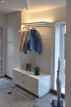 Ele & staircase designs living room design living room furniture made to measure in the münsterland region. Home Entrance Decor, House Entrance, Entryway Decor, Home Decor, Entrance Hall, White Wardrobe, Modern Hallway, Small Hallways, Staircase Design
