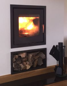 inset stove and log store Inset Fireplace, Wood Burning Fireplace Inserts, Wood Burning Fires, Stove Fireplace, Modern Fireplace, Living Room With Fireplace, Fireplace Design, Fireplace Ideas, Double Sided Stove