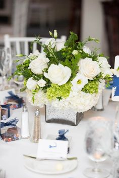 Large white rose and green centerpiece for a summer wedding! Taken at a seaside Cape Cod Wedding at Eastward Ho! - BKB & CO. | Boston Wedding Photography and Video Studio