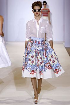 I love a white shirt with a full skirt and the sheerness of the blouse makes it a little naughty!