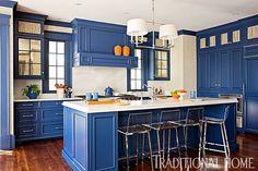We love the daring display of blue in this kitchen! - Photo: Gordon Beall / Design: Shazalynn Cavin-Winfrey