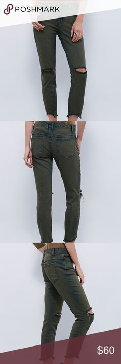 Free People - Destroyed Ankle Skinny Distressed skinny crop jean with destroyed tears at each knee. 5-pocket style with a zipper and button fly closure. Bottom gems are raw edge and lightly frayed. Stretchy fit. EUC, size 25, olive green. Free People Jeans Ankle & Cropped