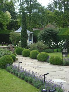 Le manoir. Round box hedging, gorgeous summer house, lavendar paths.