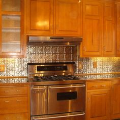 Kitchen Backsplash Pictures With Oak Cabinets punched tin backsplash with oak stained cabinets | mom country