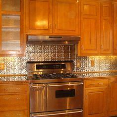 Tin Backsplash With Oak Cabinets