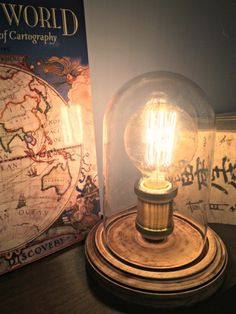 I love our new vintage Edison bulb table lamp from ParrotUncle.com! The simple dome cover allows the cool filament bulb to shine through, and the distressed wood base gives it a nice vintage touch.