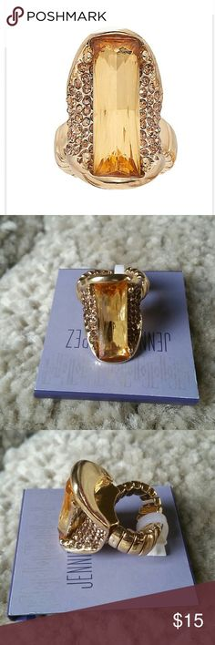 """Beautiful JLO Stretch Ring Get stylish with this stretch ring by JLO. Gold tone, champagne simulated crystal. Size: one size fits most. Width: 1.4"""". Jennifer Lopez Jewelry Rings"""
