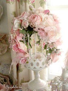Birdcage rose flower arrangement