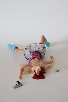 suicide barbie- when i wrote my first novel in the 90's i was the first to think of doing twisted things to barbies and had a character in my book doing this very thing, including a suicide barbie, i farkin' HATE the collective consciousness where everyone steals your ideas...