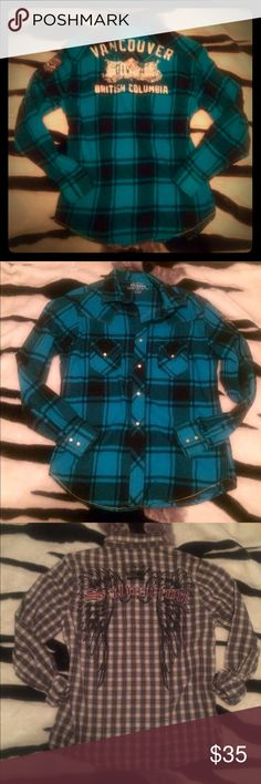 """Men's lot of 3 long sleeved flannels and plaids What guy doesn't like flannels and plaid button ups? Get him these three beauts to add to his everyday get up. :)  all size medium.  For a tighter fit a large will fit these with ease. One red Canyon plaid long sleeve, one grey and white Salvation plaid long sleeve with black print wings and crown with patch like """"salvation"""" written across the back shoulders.  Last but not least one Arizona blue warm flannel with patch on arm and white graphic…"""
