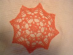 http://www.ravelry.com/patterns/library/spider-doily