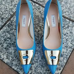 Coach Pumps 3.5 inch heel in size 7.5 B.  I wore these twice.   Very small scratch on tip of right shoe that's barely noticeable. Coach Shoes Heels