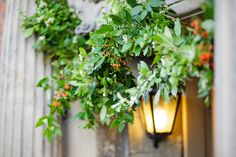 Doorway greenery garland. October.   http://www.bareblooms.co.uk/  Photography http://www.damianhall.com/.  Greenery garland idea for beam outside or window ledge?