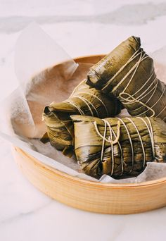 Our detailed, step-by-step Cantonese-style Zongzi recipe, a traditional Chinese savory sticky rice treat with pork, peanuts, and salted duck egg yolk eaten during the Dragon Boat festival.