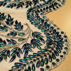 Beetle wing embroidery at Fabrics of India exhibition, V&A