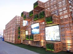 Pavilion Covered with recycled wood pallets and several LED screen at Rio 20 Exhibition, Rio De Janerio, Brazil. Photo by Paula Alvarado. Exhibition Stand Design, Exhibition Display, Exhibition Space, Green Architecture, Sustainable Architecture, Sustainable Design, Sustainable Development, Nachhaltiges Design, Booth Design