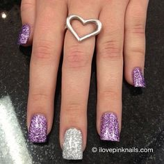 Purple and silver colored glitter acrylic nails, personally I'd do the accent nail on the ring finger but the colors are cute together.