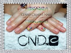 CND Shellac Grapefruit Sparkle with hand painted Spring flowers on little fingers. By Claire's Creative Nails, Northampton. Call or text; 07752 397245 to book your appointment. #shellac #ibx #northampton #NailSalon #NailArt #cnd
