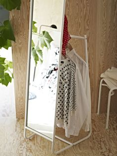 As seen on the new 2015 IKEA catalog cover: KNAPPER floor mirror. Hiding behind the mirror are hooks and a rail for clothes hangers. A practical solution that makes it easy for you to keep everything from blazers and jackets to jewelry and bags in one place.