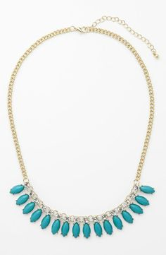 Sparkly crystals and turquoise stones make this necklace perfect for prom.