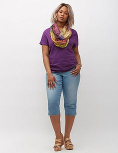 Lightweight slub tee flatters with a sexy V-neck and side shirring to define the fit. Short sleeves. Great for layering! lanebryant.com