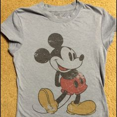 Vintage look Mickey Mouse baby doll tee Like new condition purchased from a Disney resort gift shop in 2010, wore it twice (maybe). Please note Mickey is intentionally distressed, I bought it like that. Offers welcome ✌️ Disney Tops Tees - Short Sleeve