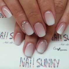 Beautiful spring nails! Sophisticated ombre white and nude or beige short squoval nail polish design #springnails #nailartideas #nailart #nailpolishideas #nailsforspring #nailsoftheday #manicure #nailshapes #beautynails