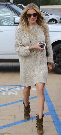 Off-duty chic: LeAnn Rimes covered up in a jumper dress and cowboy boots for a visit to No...