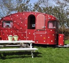 A red and white polka dot vintage camper!