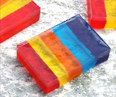 DIY rainbow layered soap is an easy soap recipe made with melt and pour soap base that is dyed and then layered for a fun, easy craft perfect for adults and kids. Diy Crafts To Sell On Etsy, Diy Crafts For Girls, Easy Crafts, Squishies, Handmade Soap Recipes, Handmade Soaps, Soap Making Kits, Making Oils, Jelly Soap