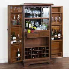 Crafted of walnut solids and veneers, this bar armoire is finished in an antique charcoal glaze. The Savannah armoire includes two full-length doors with built-in shelves and twenty one wire racks for wine bottles.