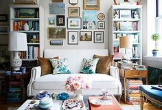 It can be daunting to fill a large empty wall. To help you  create an arrangement you love, we've gathered an array of  artwork, mirrors, and more wall decor—all perfect for mixing  and matching in any room. Read on for ideas and get inspired.  Home of Heather Clawson