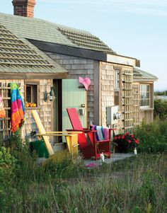 Pops of Color Bold red and yellow deck chairs pop against the muted exterior of this Nantucket home. Come summer, the trellises on the walls and even the roof are swathed in lush pink climbing roses.