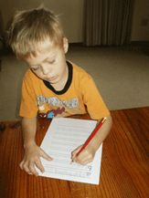 teaching left handed kids to write so they can see what they're writing & not smudge the writing