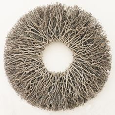 Simply stunning, this wreath consists purely of branches arranged into a pleasing design. This wreath is quite deep giving it a real architectural air. Whether you leave it plain or decorate it it will be a striking adornment to any wall.  dimensions: (100) approx 100cm in diameter and 15cm in depth (80) approx 80cm in diameter