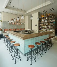 formafatal completes argentinean gran fierro restaurant in prague // Love the industrial chic and turquoise tiles