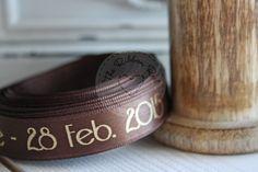 Personalised wedding ribbon using our metallic gold foil on brown satin ribbon