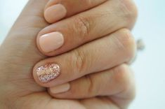 neutral manicure with glitter accent nail